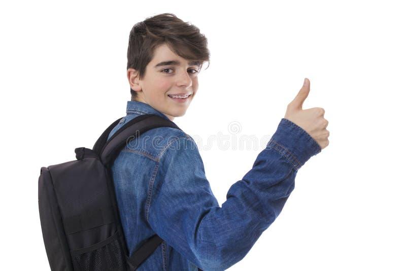 Σπουδαστές με το θετικό χαιρετισμού σακιδίων πλάτης και χεριών στοκ φωτογραφία