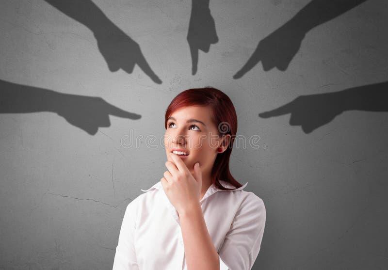 Σπουδαστής με την υπόδειξη της έννοιας χεριών στοκ εικόνα