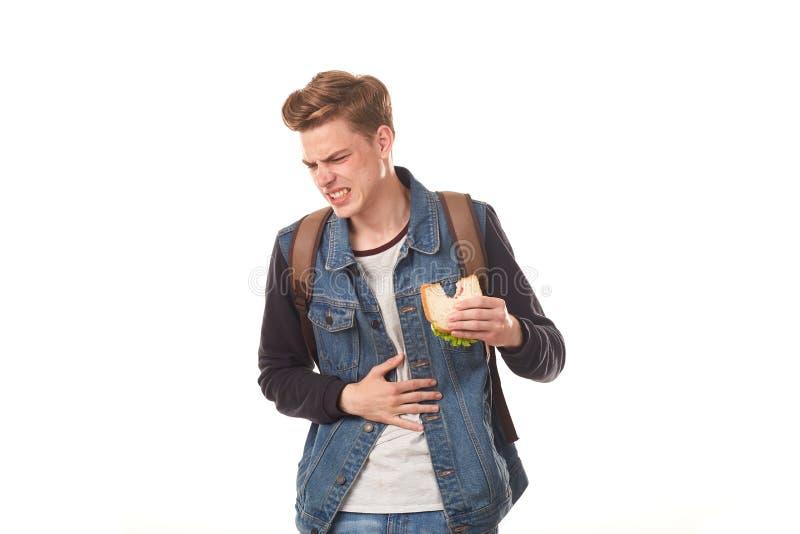 Σπουδαστής που τρώει το σάπιο σάντουιτς στοκ εικόνα