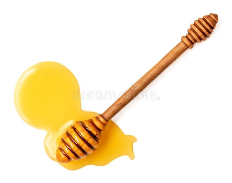 Στάλαγμα μελιού που απομονώνεται σε ένα άσπρο υπόβαθρο Φυσικό μέλι μελισσών στοκ φωτογραφίες με δικαίωμα ελεύθερης χρήσης