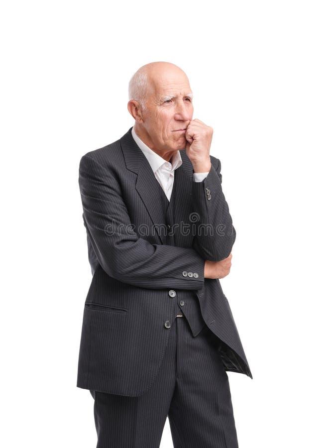 Στάσεις παππούδων σκεπτικά απομονωμένο στο λευκό υπόβαθρο στοκ φωτογραφία με δικαίωμα ελεύθερης χρήσης