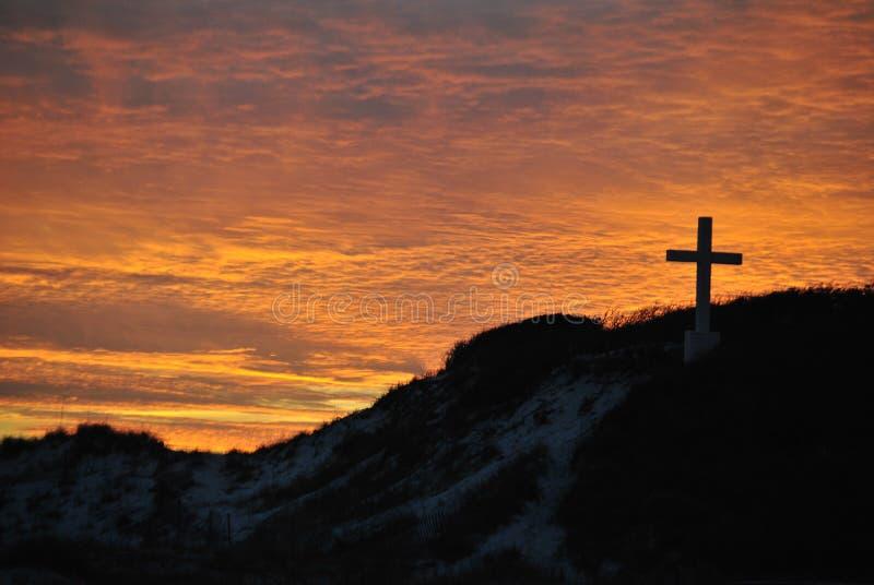 Σταυρός στο ηλιοβασίλεμα στοκ φωτογραφία