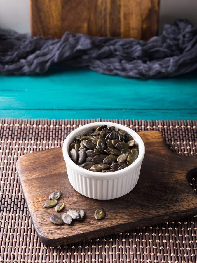 στενοί σπόροι κολοκύθας τροφίμων ανασκόπησης επάνω Πρωτεϊνική πηγή Vegan στοκ εικόνες