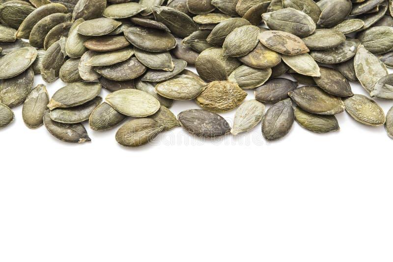 στενοί σπόροι κολοκύθας τροφίμων ανασκόπησης επάνω στοκ εικόνα