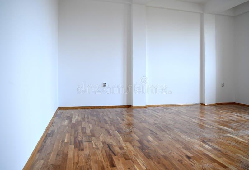 Στενός επάνω πατωμάτων παρκέ Κενό δωμάτιο διαμερισμάτων στοκ εικόνα με δικαίωμα ελεύθερης χρήσης