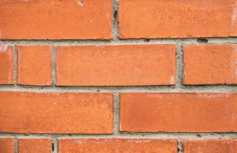 Στενός επάνω σύστασης τουβλότοιχος Πορτοκαλιά κίτρινη μακροεντολή τεκτονικών Υπόβαθρο πλινθοδομής grunge Τούβλο που τοποθετούνται στοκ φωτογραφία με δικαίωμα ελεύθερης χρήσης