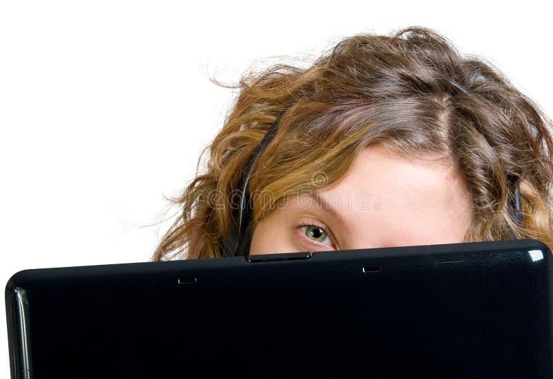 στενό lap-top ακουστικών επάνω &sigma στοκ εικόνα