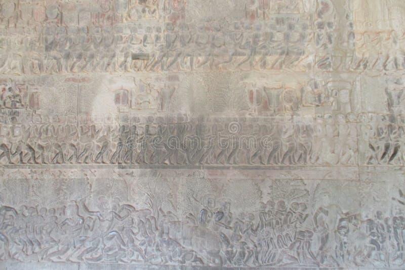 Στοά ανακούφισης της Καμπότζης Angkor Wat Bas Αυτές οι γλυπτικές που παρουσιάζουν καθημερινές ζωές κατά τη διάρκεια εκείνου του χ ελεύθερη απεικόνιση δικαιώματος