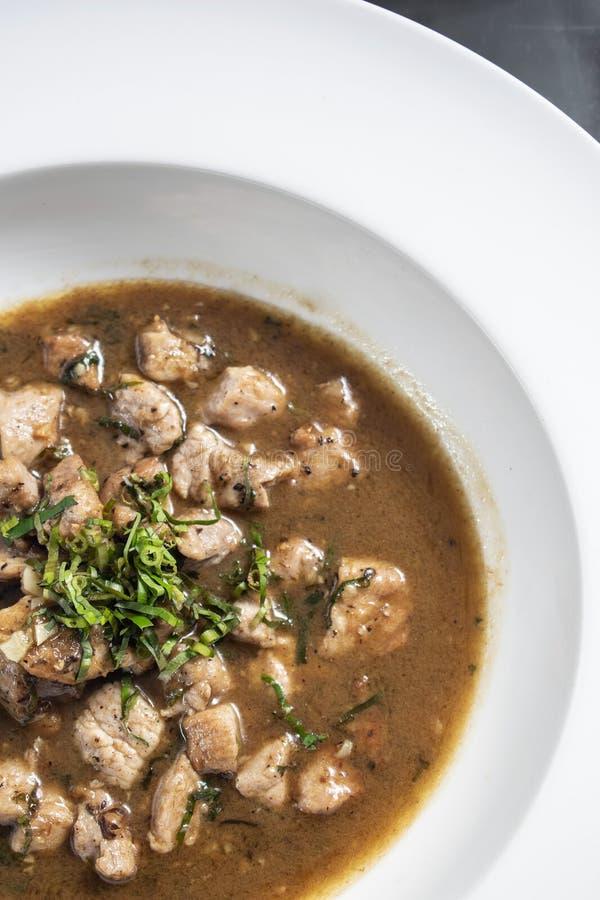 Στοιχείων 12 στιγμών του Πάου παραδοσιακό πορτογαλικό stew χοιρινού κρέατος τροφίμων πικάντικο στη Λισσαβώνα στοκ εικόνες