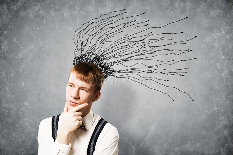 Στοχαστικό redhead 'brainstorming' σπουδαστών στοκ φωτογραφία με δικαίωμα ελεύθερης χρήσης