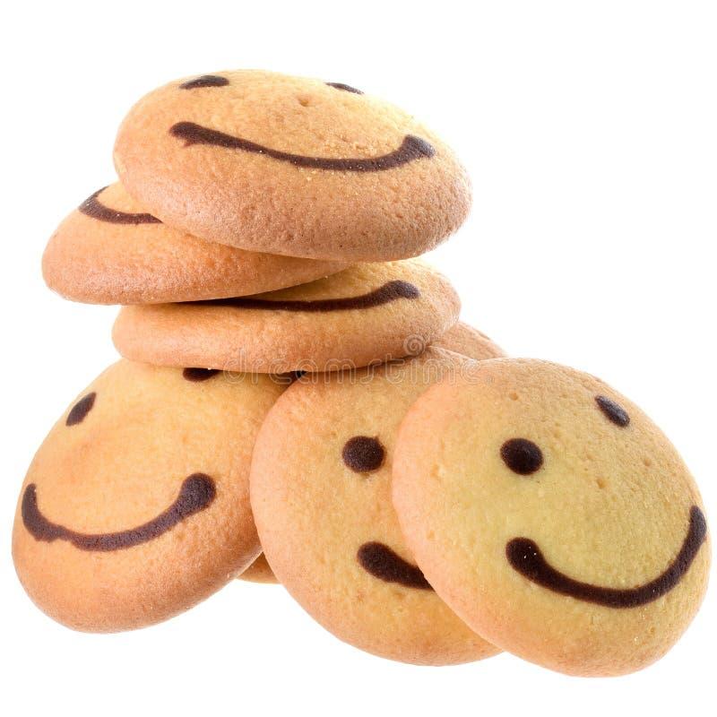 Στρογγυλό μπισκότο με την εικόνα χαμόγελου που απομονώνεται στοκ εικόνες