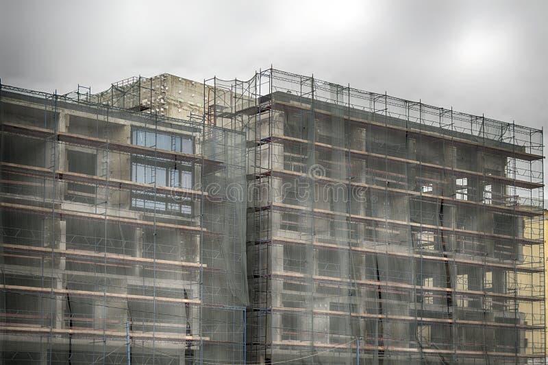 Συγκεκριμένα επιχειρησιακά κτήρια κάτω από την αποκατάσταση στοκ εικόνα με δικαίωμα ελεύθερης χρήσης