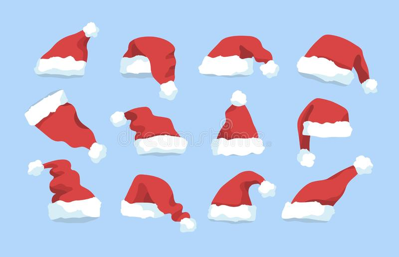 Συλλογή των κόκκινων χειμερινών καπέλων Άγιου Βασίλη που απομονώνεται στο μπλε υπόβαθρο Δέσμη των διακοσμήσεων Χριστουγέννων διακ ελεύθερη απεικόνιση δικαιώματος