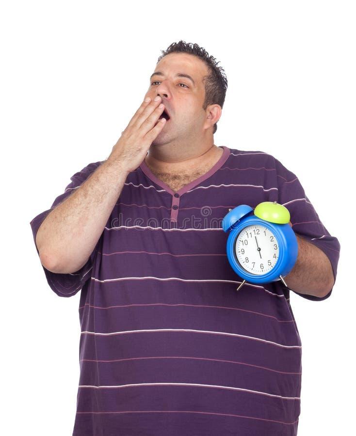συναγερμών μπλε χασμουρητό ατόμων ρολογιών παχύ στοκ εικόνες