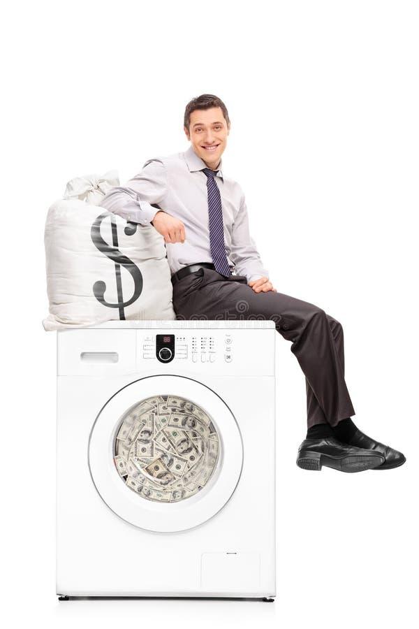 Συνεδρίαση επιχειρηματιών στο σύνολο πλυντηρίων των χρημάτων στοκ εικόνες