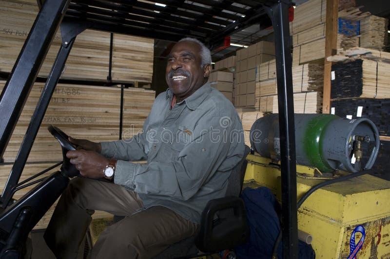 Συνεδρίαση εργαζομένων αποθηκών εμπορευμάτων Forklift στοκ φωτογραφία με δικαίωμα ελεύθερης χρήσης