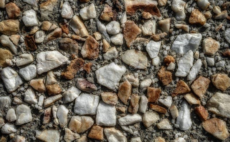 Συνολική οδός βράχου και άμμου για το υπόβαθρο σύστασης στοκ εικόνα