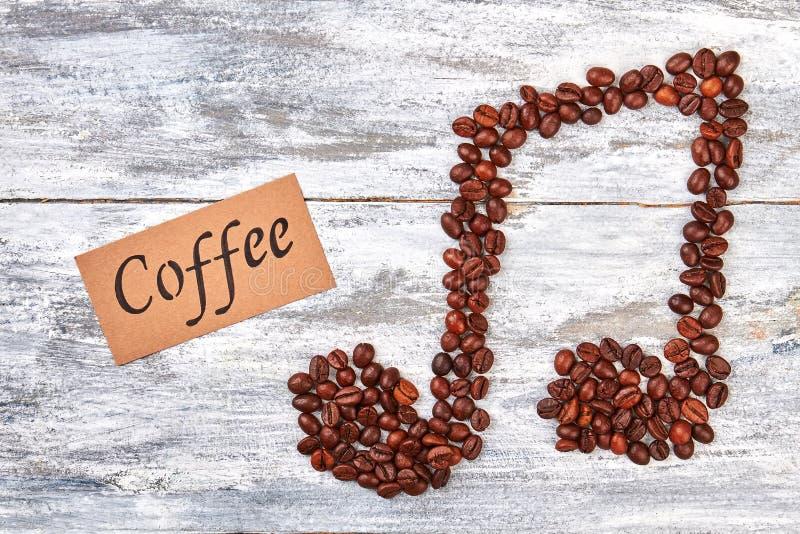 Συντονίστε από τα φασόλια καφέ, μήνυμα στοκ φωτογραφίες με δικαίωμα ελεύθερης χρήσης