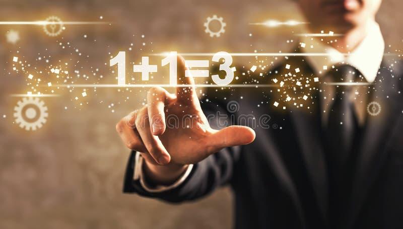 1 συν 1 ίσο κείμενο 3 με τον επιχειρηματία στοκ φωτογραφία