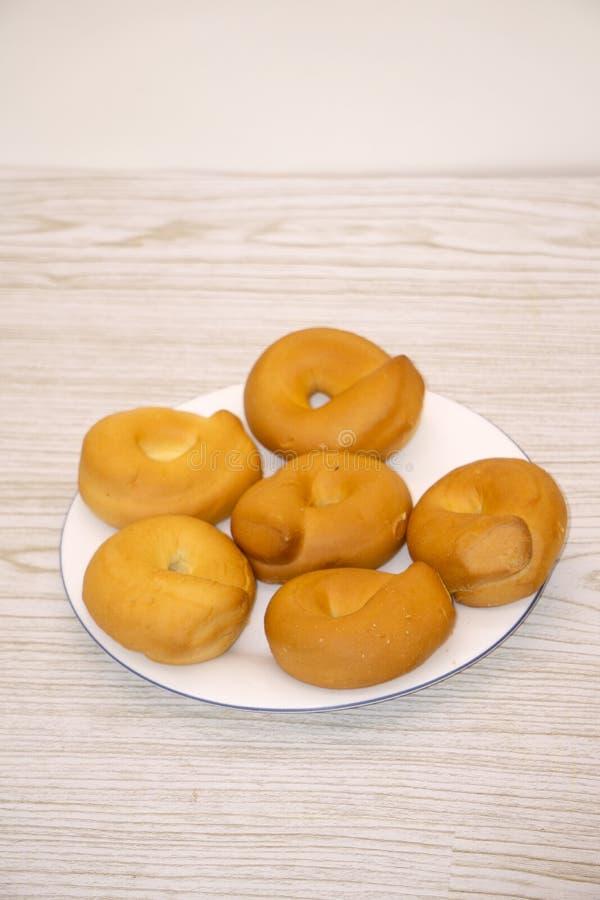 Συσσωρευμένος πρόσφατα ψημένος Bagels ψωμιού κύκλος αντικειμένου στοκ φωτογραφία με δικαίωμα ελεύθερης χρήσης