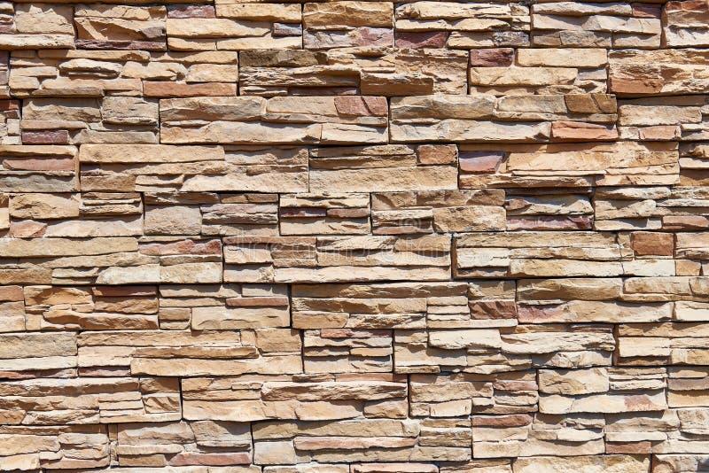 Συσσωρευμένο υπόβαθρο τοίχων πετρών οριζόντιο στοκ εικόνες