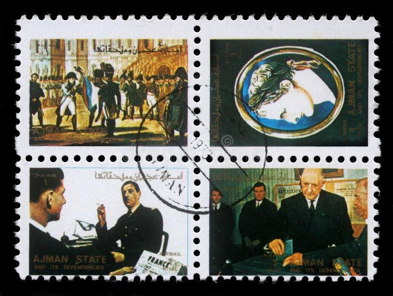 Συλλογή των γραμματοσήμων που τυπώνονται σε Ajman που παρουσιάζει εικόνες διάσημοι άνδρες και γυναίκες στοκ εικόνα