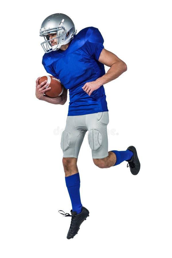 Σφαίρα εκμετάλλευσης φορέων αμερικανικού ποδοσφαίρου στον αέρα στοκ εικόνα