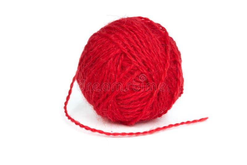 Σφαίρα του κόκκινου νήματος μαλλιού στοκ εικόνες