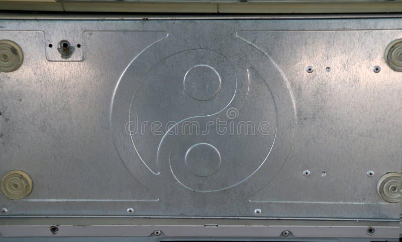 Σχέδιο πιάτων αργιλίου του yin yang Είναι το μέρος της περίπτωσης υπολογιστών στοκ φωτογραφία