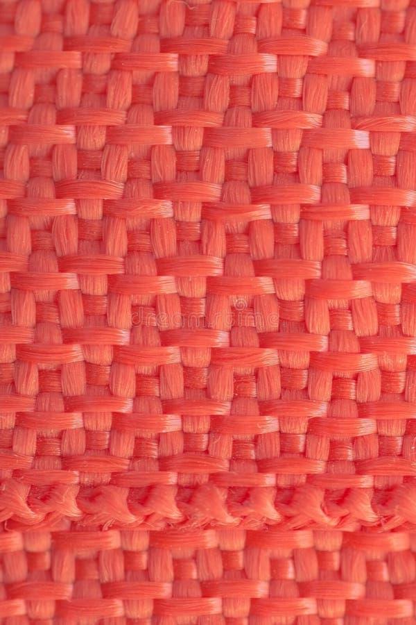 Σχέδιο υποβάθρου που πλέκεται από τα τεχνητά νήματα στοκ φωτογραφίες με δικαίωμα ελεύθερης χρήσης