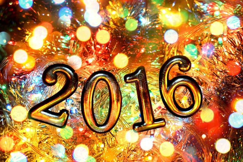 Σχήματα 2016 (νέο έτος, Χριστούγεννα) στα φωτεινά φω'τα στοκ φωτογραφία με δικαίωμα ελεύθερης χρήσης