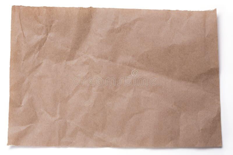 Σχισμένα τσαλακωμένα κομμάτια της συσκευασίας του χαρτί   στο λευκό στοκ φωτογραφία