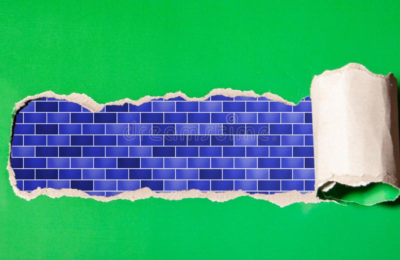 Σχισμένη λουρίδα της Πράσινης Βίβλου με την μπλε πλινθοδομή στοκ εικόνα