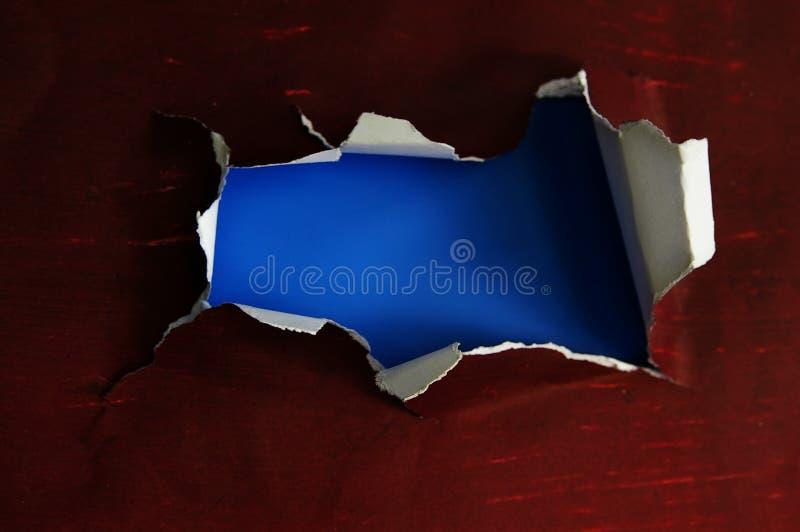 Σχισμένη τρύπα εγγράφου στοκ φωτογραφία