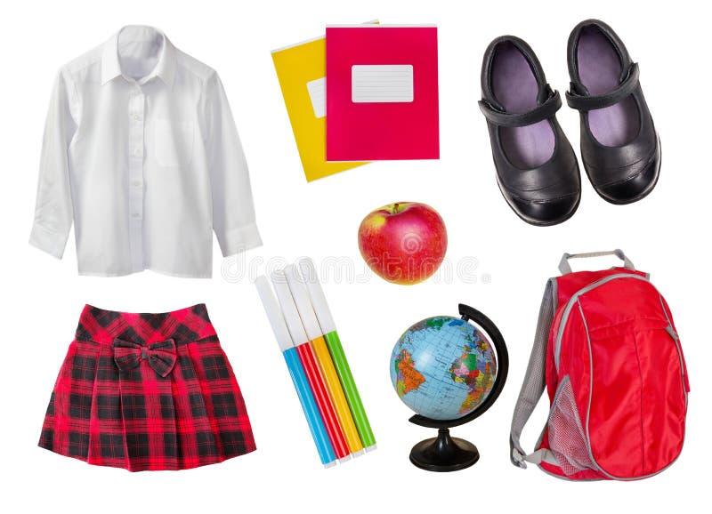 Σχολικοί θηλυκοί ομοιόμορφος & προμήθειες που απομονώνεται στο λευκό στοκ εικόνα με δικαίωμα ελεύθερης χρήσης
