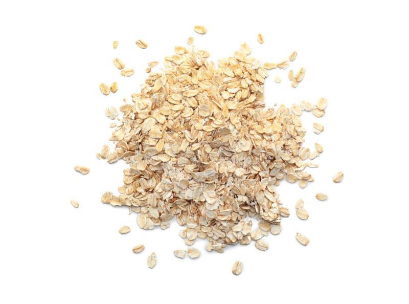 Σωρός ακατέργαστο oatmeal στο άσπρο υπόβαθρο στοκ εικόνα με δικαίωμα ελεύθερης χρήσης