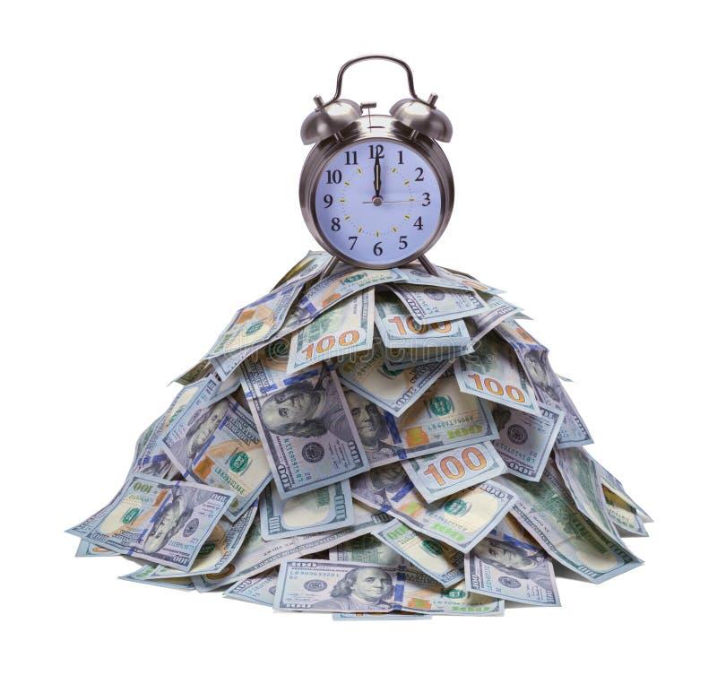 Σωρός και ρολόι χρημάτων στοκ φωτογραφία