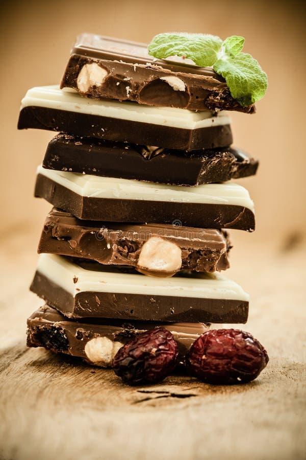 Σωρός της διαφορετικών σοκολάτας και του του βακκίνιου ειδών στοκ εικόνες με δικαίωμα ελεύθερης χρήσης