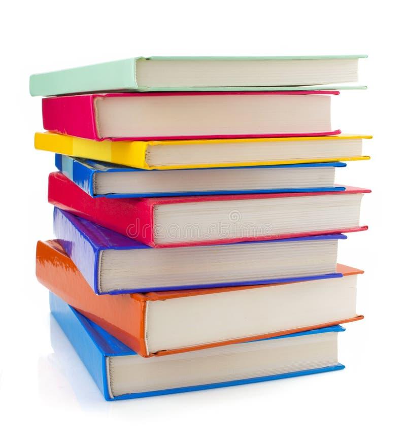Σωρός των βιβλίων στο λευκό στοκ εικόνες