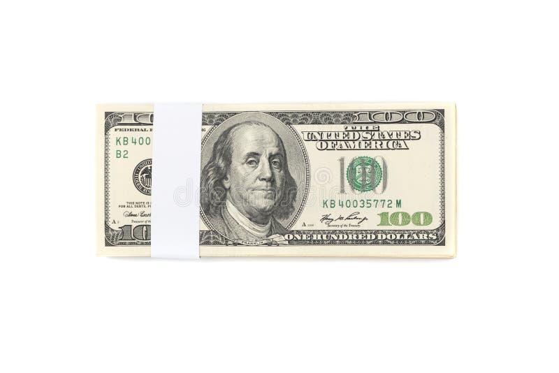 Σωρός των λογαριασμών χρημάτων εκατό αμερικανικών δολαρίων που απομονώνονται στη λευκιά ΤΣΕ στοκ εικόνες