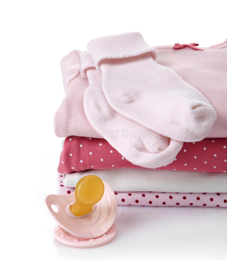 Σωρός των ρόδινων ενδυμάτων μωρών στοκ εικόνες
