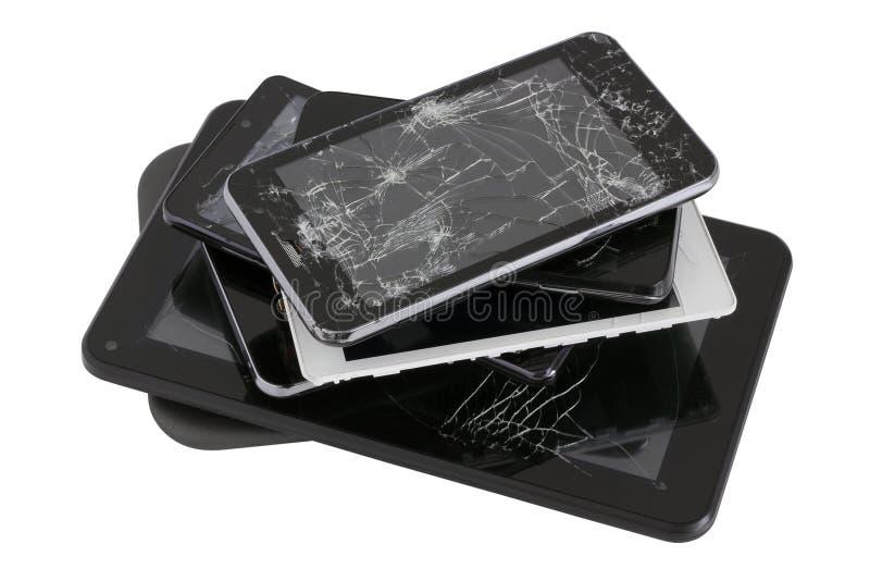Σωρός των συσκευών με τις σπασμένες οθόνες στοκ φωτογραφία