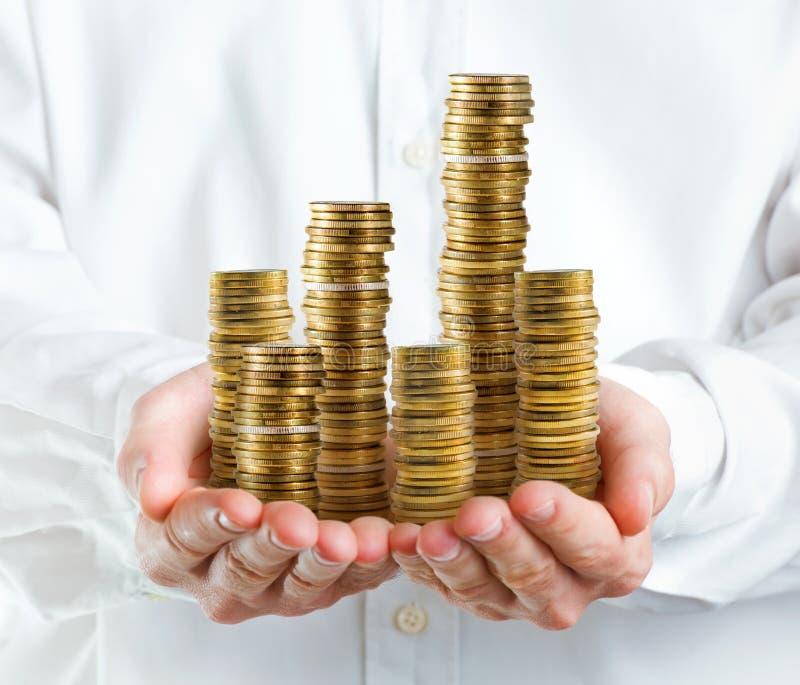 Σωρός των χρημάτων στα χέρια στοκ εικόνες
