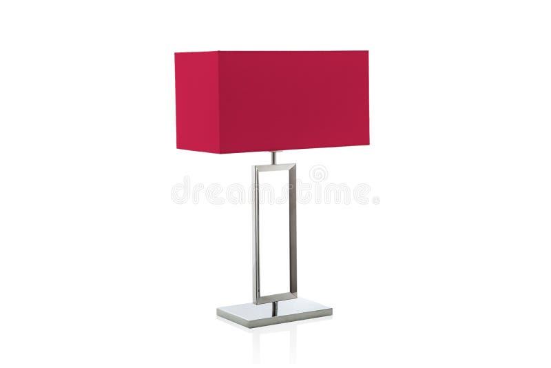 Σύγχρονος επιτραπέζιος λαμπτήρας με μικρό κόκκινο lampshade στοκ εικόνα