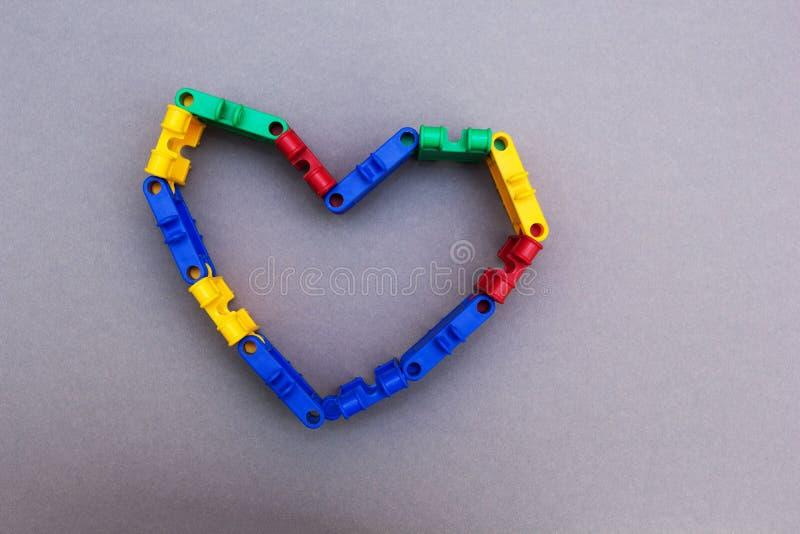 Σύμβολο της καρδιάς από το σχεδιαστή σε ένα γκρίζο υπόβαθρο, έννοια στοκ φωτογραφία με δικαίωμα ελεύθερης χρήσης