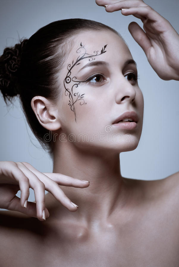 Σύνθεση μόδας με την τέχνη προσώπου. στοκ εικόνα
