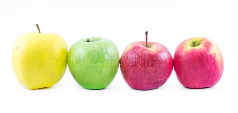 Download Σύνθεση τριών τύπων μήλων που παρατάσσονται το ένα δίπλα στο άλλο σε ένα άσπρο υπόβαθρο - πράσινο, κίτρινο και κόκκινο - ακόμα ζω Στοκ Εικόνα - εικόνα από τύποι, νόστιμος: 62701725