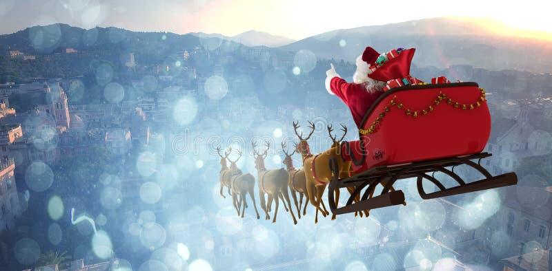 Σύνθετη εικόνα Άγιου Βασίλη που οδηγά στο έλκηθρο με το κιβώτιο δώρων στοκ εικόνες με δικαίωμα ελεύθερης χρήσης