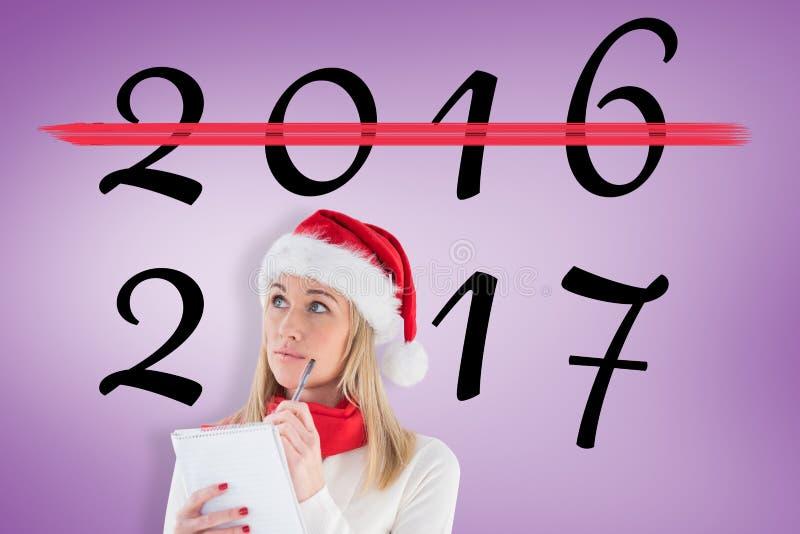 Σύνθετη εικόνα εορταστικού ξανθού γράφοντας τον κατάλογο Χριστουγέννων της στοκ εικόνα