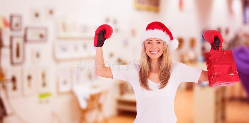 Σύνθετη εικόνα εορταστικό ξανθό punching με τα εγκιβωτίζοντας γάντια στοκ φωτογραφίες με δικαίωμα ελεύθερης χρήσης